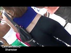 Latina wearing black leggins at public event