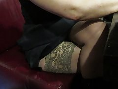 Touching her legs in tan stockings in a restautant