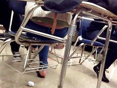 Candid feet flip flops on chair