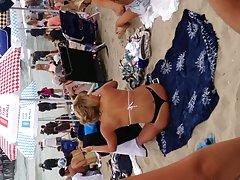 Blonde black thong on beach