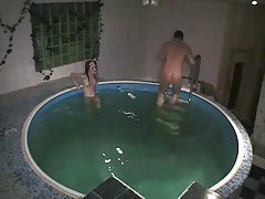 Handjob and sex with skinny brunette in the pool