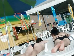 Two young not sisters in waterpark