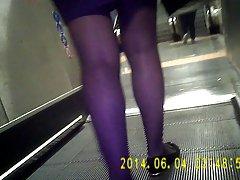 Bank girl in shiny black pantyhose