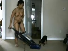 Hairy nudist black woman cleans the house