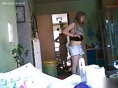 Smart Girl Putting On A Black Bra